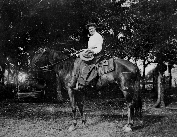 Sallie Day on a horse on Newning Avenue
